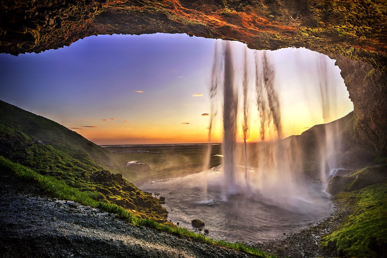 Behind Seljalandsfoss Waterfall at Sunrise